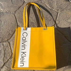 Calvin Klein yellow spell out tote bag